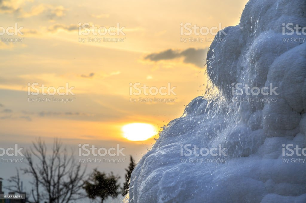 Pamukkale travertine basin during sunset stock photo