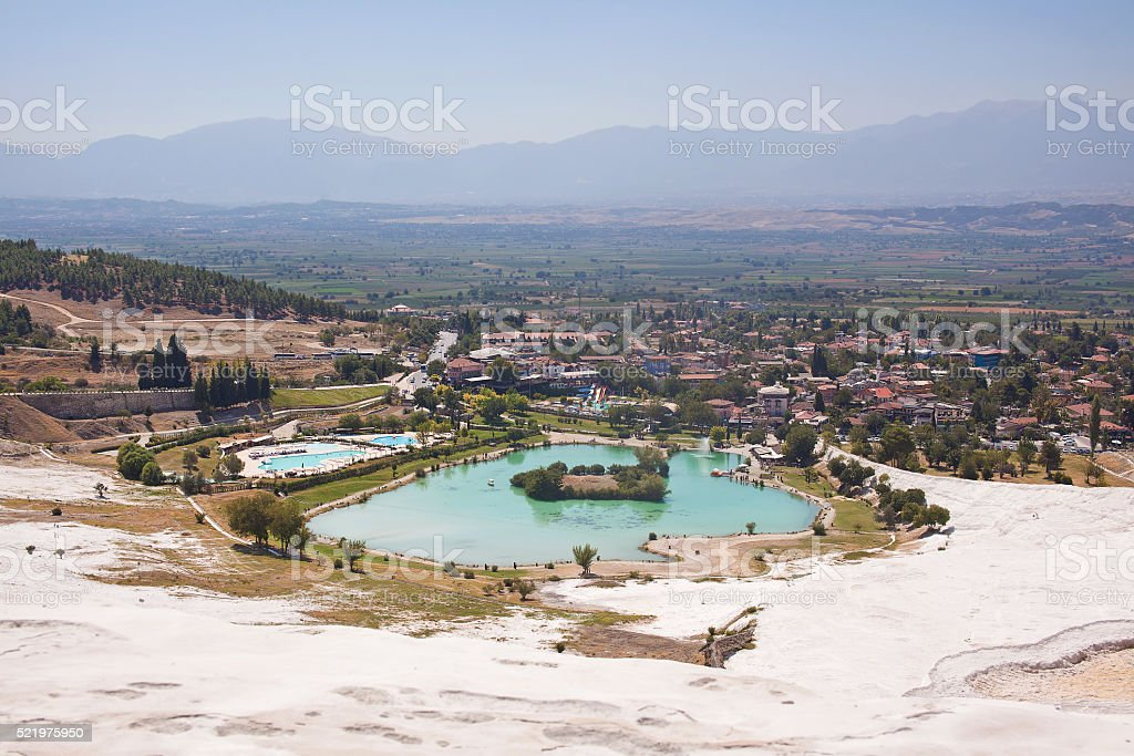 Pamukkale. Turkey. Mountain slope with travertine and valley with lake stock photo