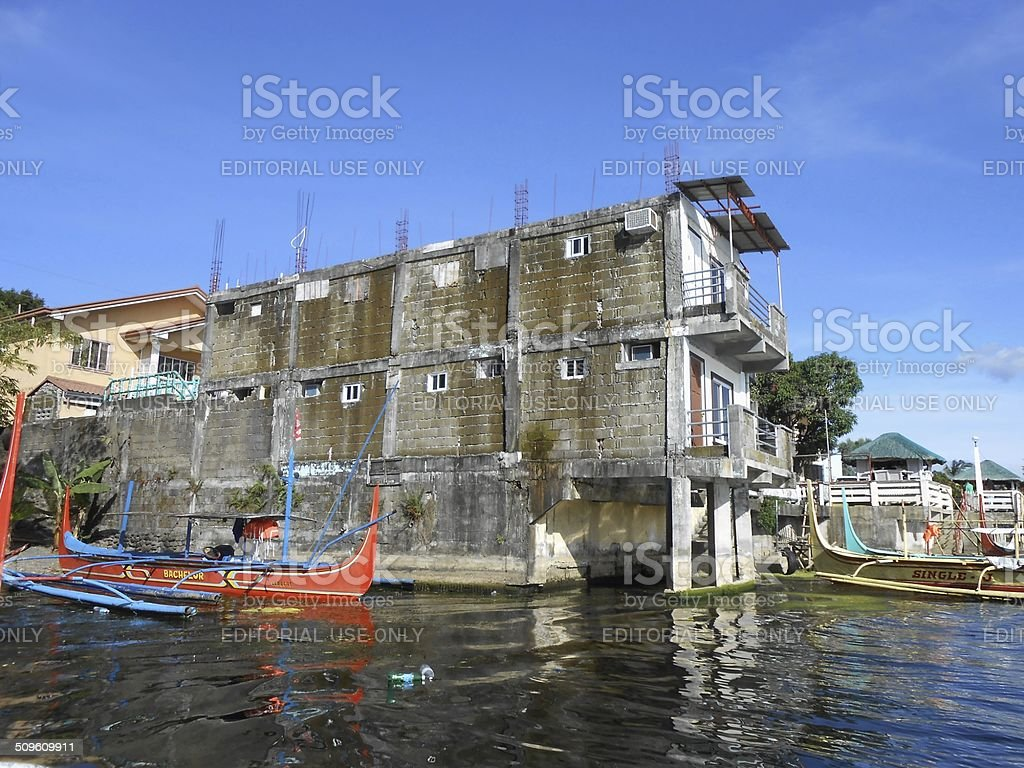 Pan boats moored at Talisay village, Lake Taal Philippines stock photo
