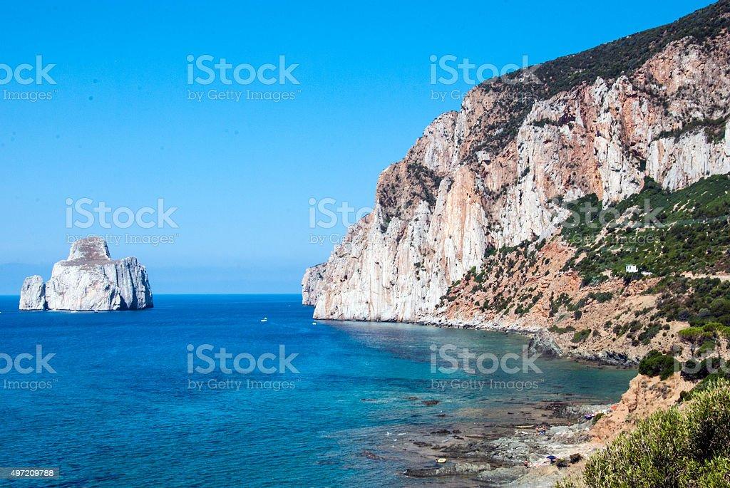 Pan di Zucchero rocks in sea, Masua stack (Nebida)  Sardinian stock photo