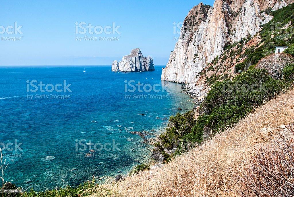 Pan di Zucchero rocks in sea, Masua stack (Nedida) Sardinian stock photo