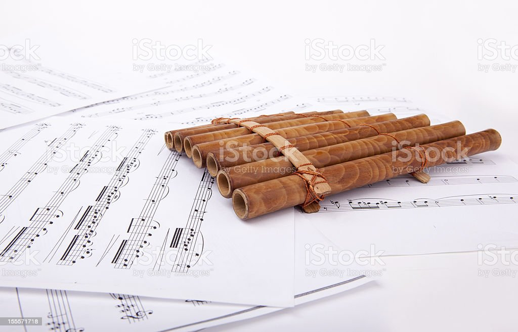 pan flute and sheet music royalty-free stock photo