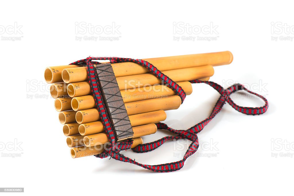 Pan flute on a white background stock photo