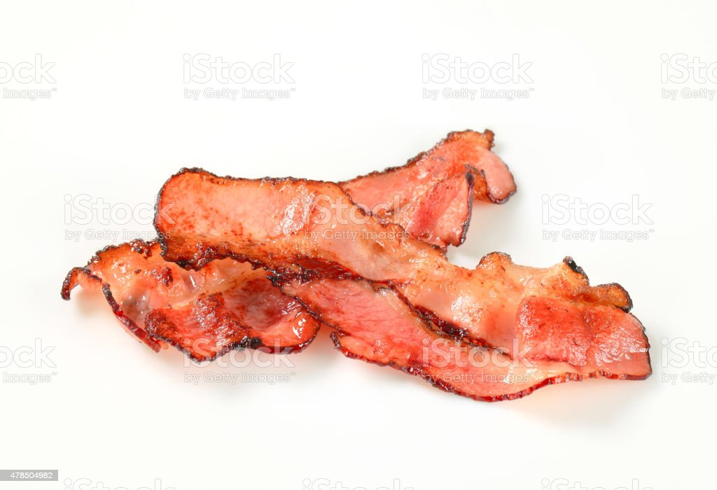Pan fried bacon strips stock photo