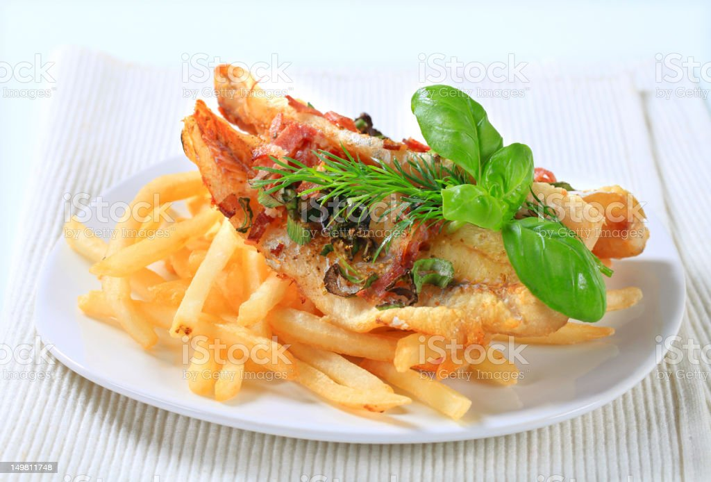 Pan fried fish fillets with fries stock photo