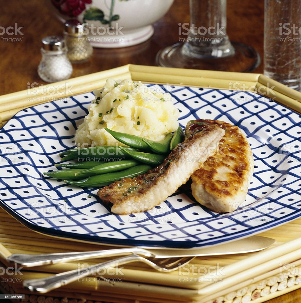 Pan fried fish with mashed potatoes and snow peas. royalty-free stock photo