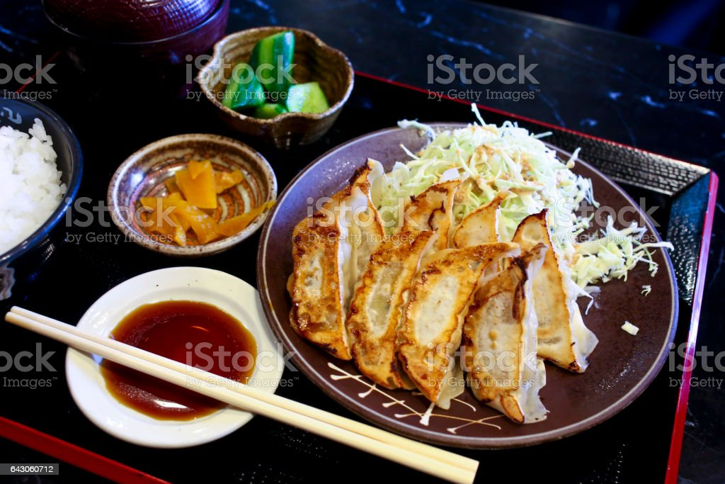 Pan Fried Gyoza with Steamed Rice stock photo