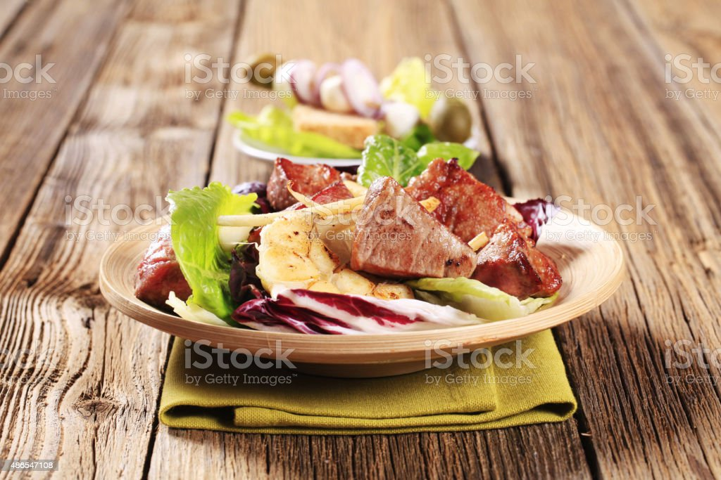 Pan fried pork and vegetable salad stock photo
