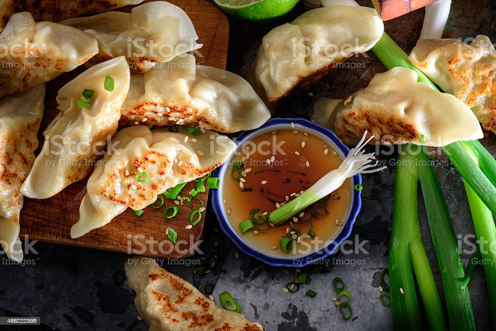 Pan Fried Pot Stickers with soy sauce stock photo