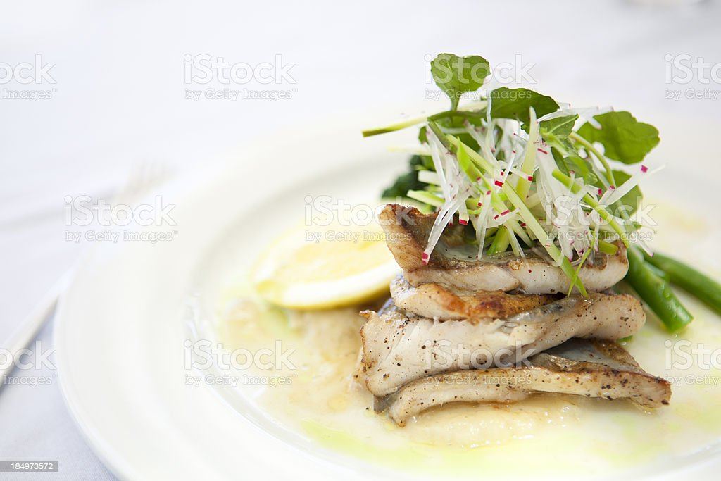 Pan fried snapper with green vegetables and parsnip puree stock photo