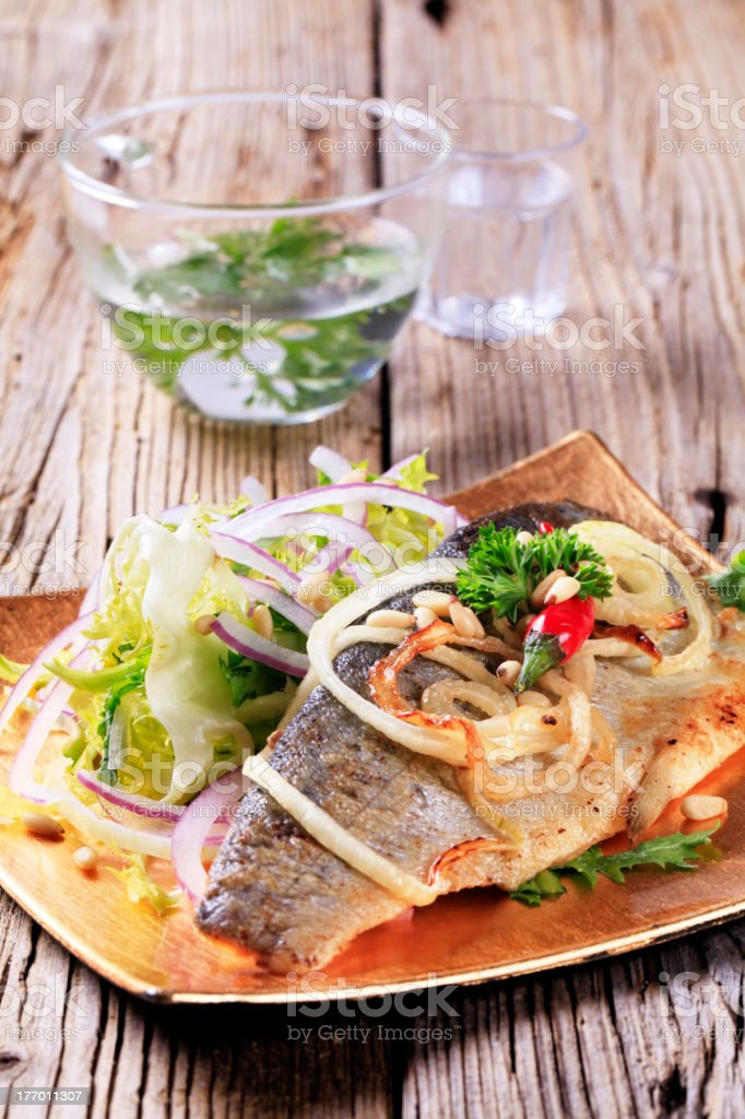 Pan fried trout and green salad royalty-free stock photo