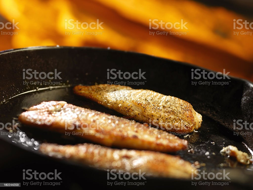 Pan Fried Trout on the Campfire stock photo