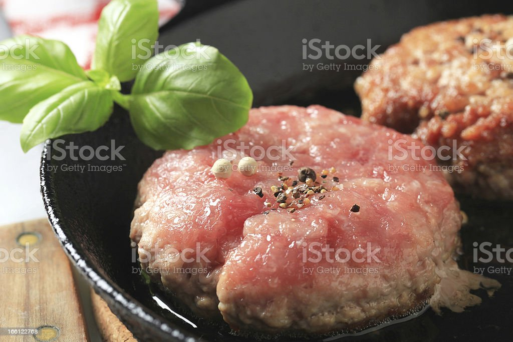 Pan frying patties royalty-free stock photo
