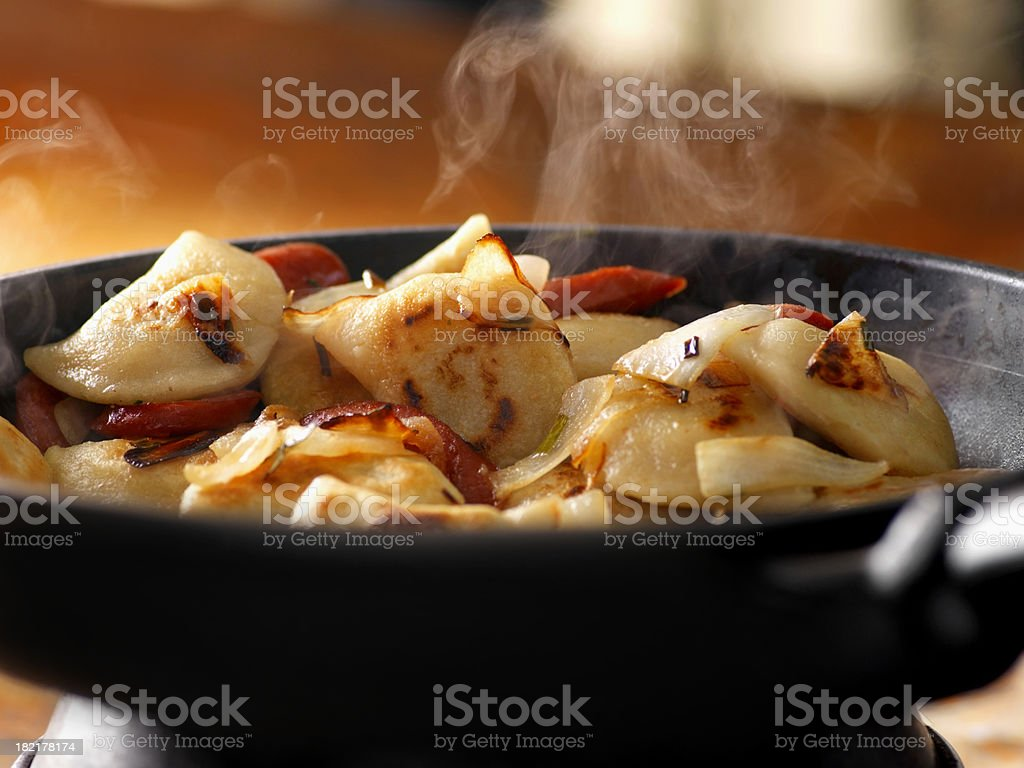 Pan Frying Perogies stock photo