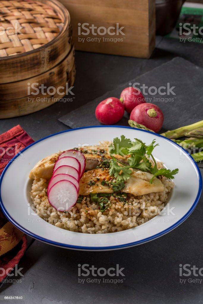 Pan Grilled Tilapia over Brown Rice stock photo