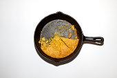 Pan of cornbread in a cast iron skillett isolated on