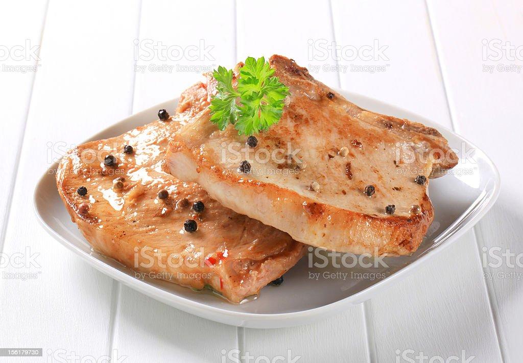 Pan seared pork chops royalty-free stock photo