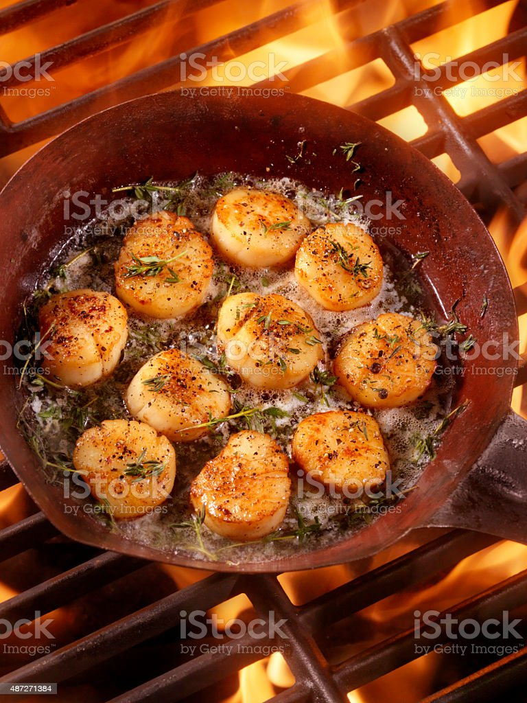 BBQ Pan Seared Scallops in Butter stock photo