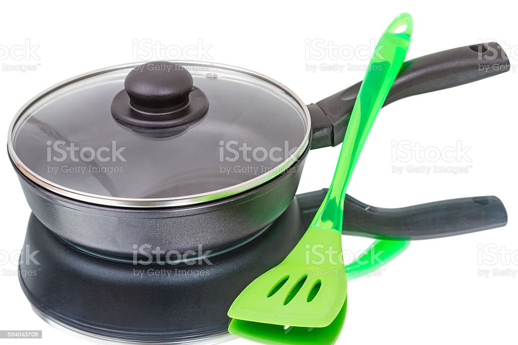 Pan with glass lid and spatula stock photo