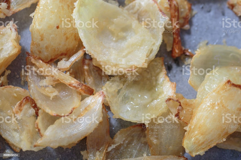 Pan with pieces of onion fry stock photo