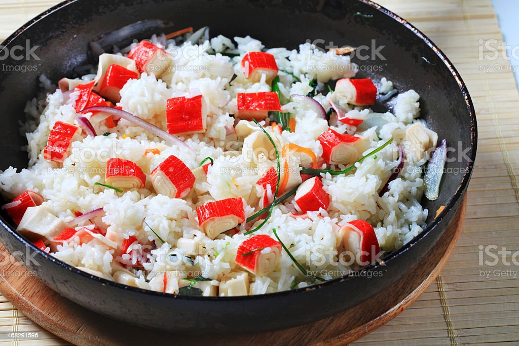 Pan with rice and crabstick stock photo