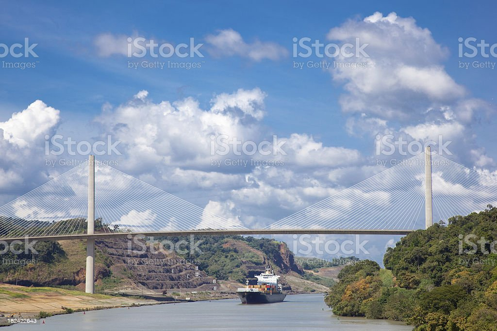 Panama Canal With Cargo Ship Passing Under The Centennial Bridge stock photo