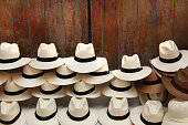Panama hats piled up against a wooden door, Cartagena, Colombia.