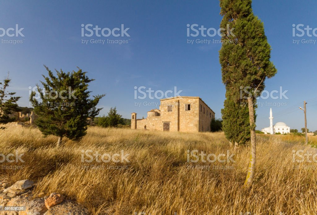 Panayia Kanakaria Monastery Church and mosque, Cyprus- mosque in background stock photo