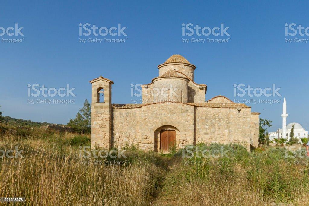 Panayia Kanakaria Monastery Church, Cyprus- mosque in background stock photo