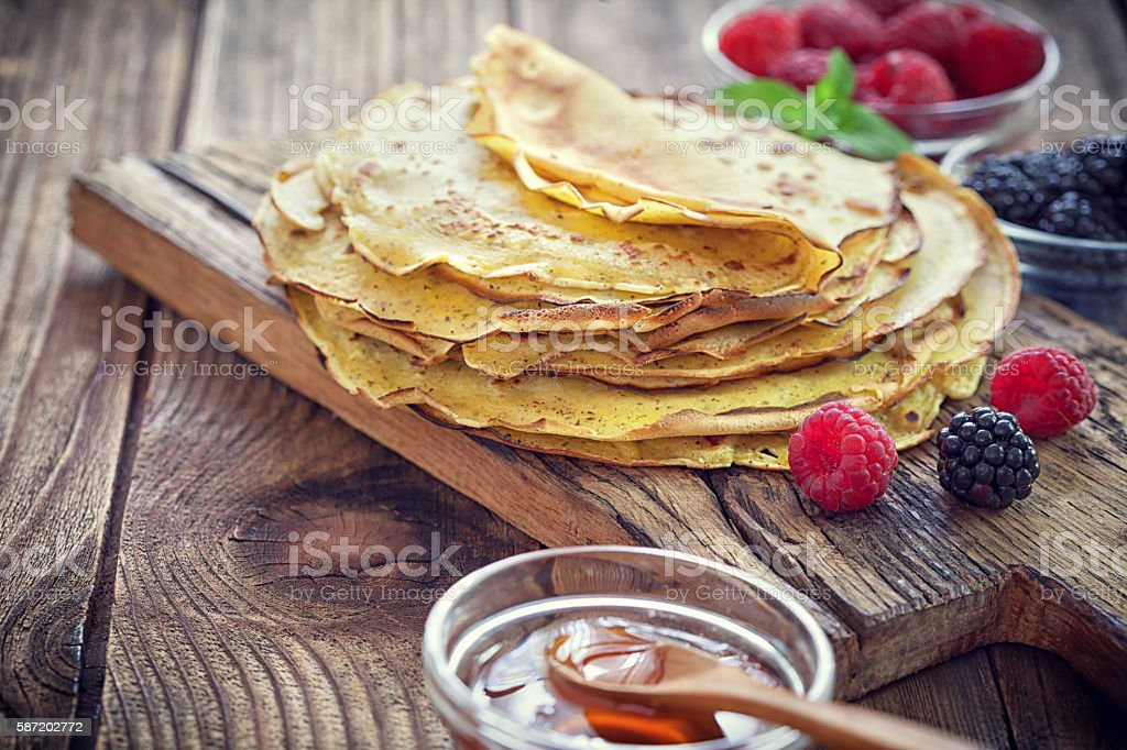 Pancake - Crepes with berries, mint and honey stock photo