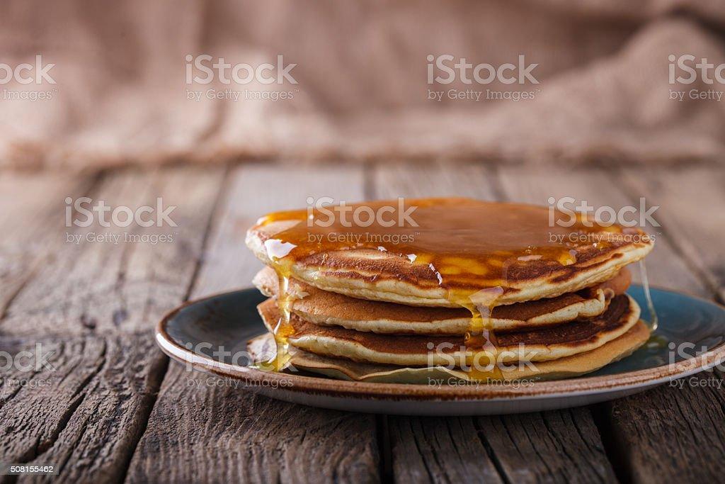 Pancake folded stack of with liquid honey stock photo