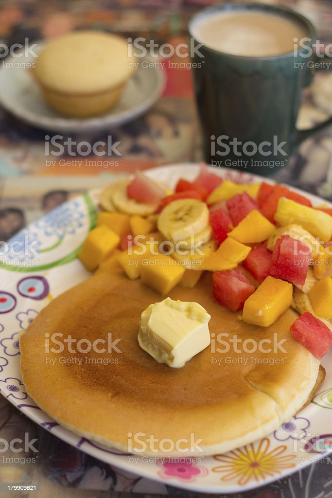 Pancake served with fruit toppings royalty-free stock photo