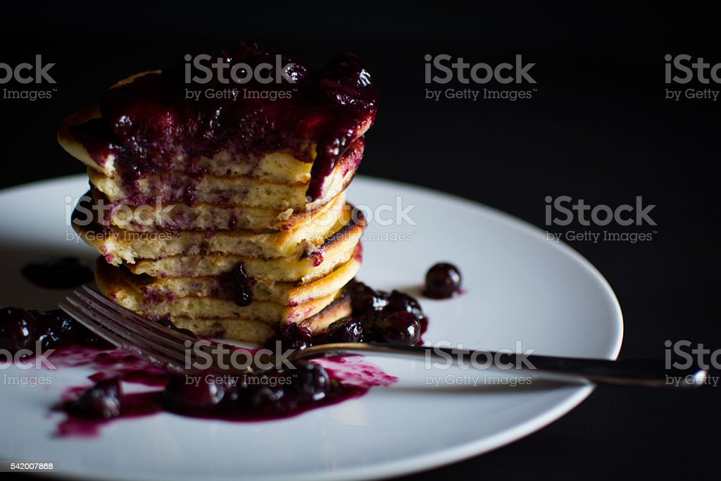 Pancake Stack and Blueberries on white with black stock photo