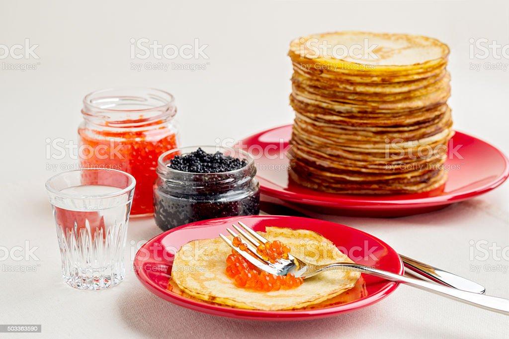 Pancake week. Pancakes with red and black caviar. stock photo