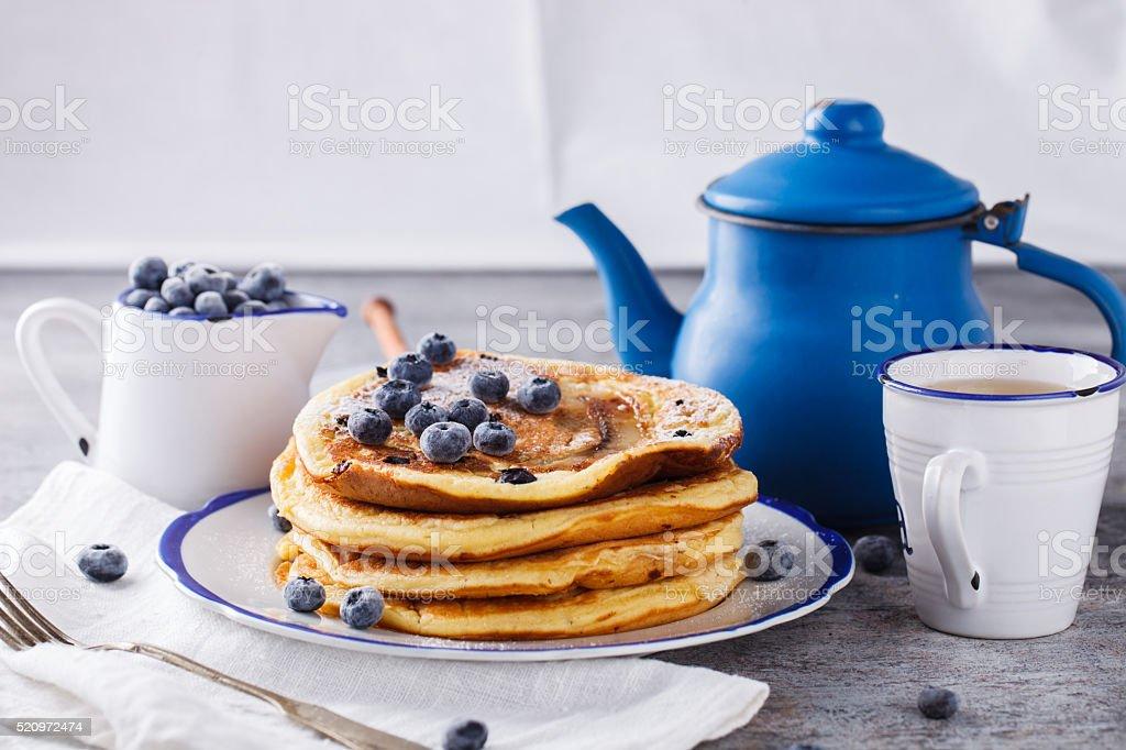 Pancake with banana , blueberries and honey. stock photo