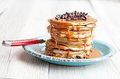 Pancake with caramel and chocolate shavings