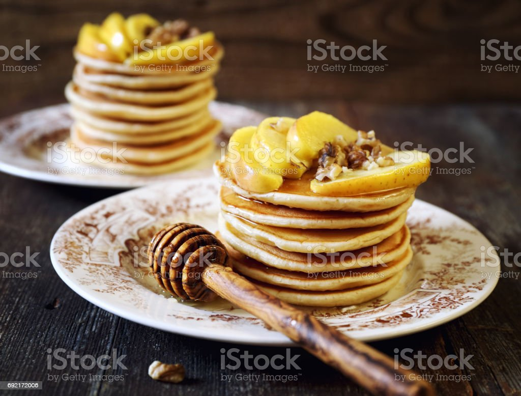 Pancake with honey, apples and walnuts stock photo