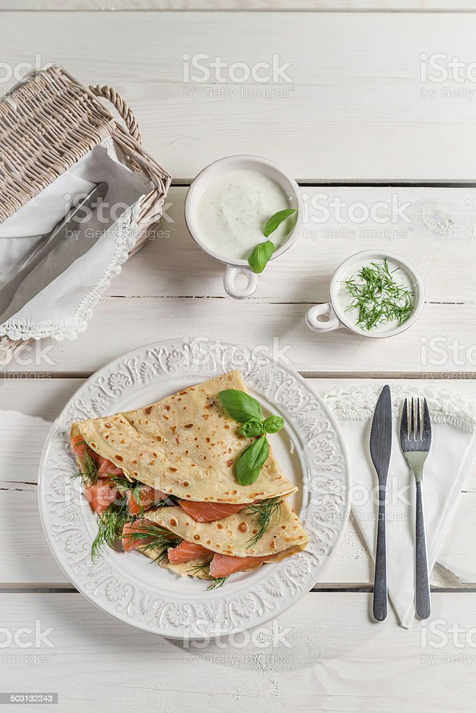 Pancake with salmon and dill stock photo