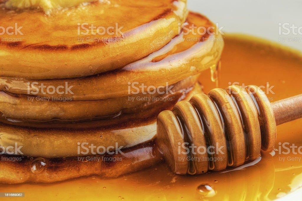 Pancakes and honey royalty-free stock photo