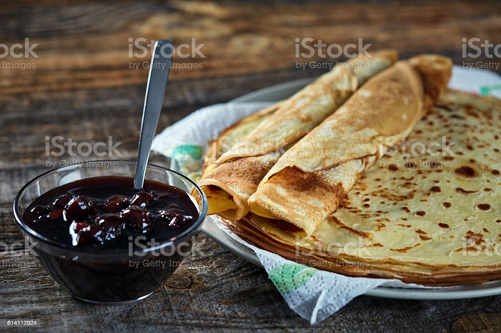 Pancakes filled with cherry jam stock photo