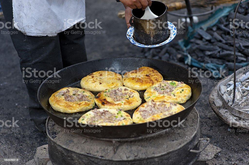 Pancakes in pan stock photo