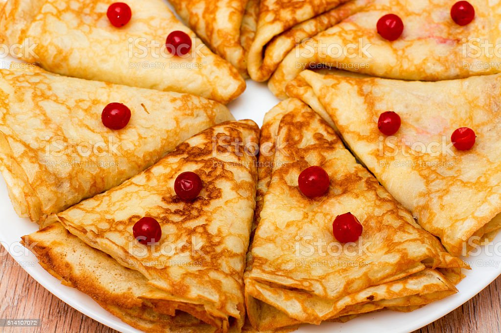 Pancakes rolled triangle stock photo