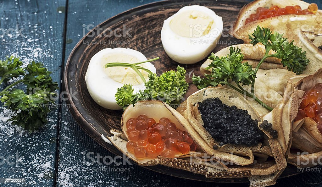 pancakes stuffed with seafood stock photo
