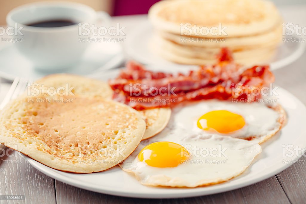 Pancakes with Bacon and Eggs stock photo