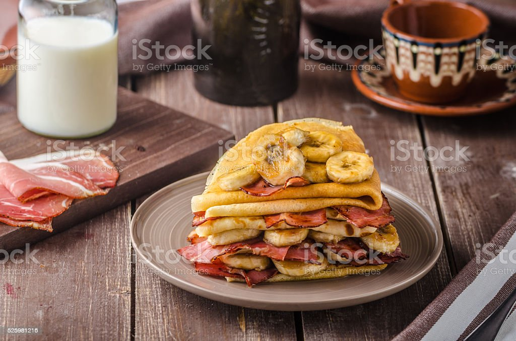 Pancakes with bacon, banana and maple sirup stock photo