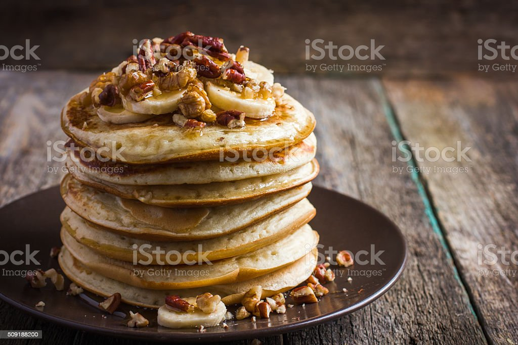 pancakes with banana, nuts and honey stock photo