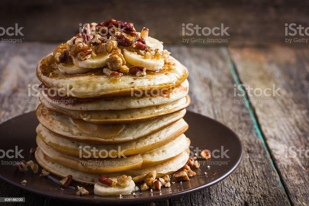 pancakes with banana, nuts and honey stock photo