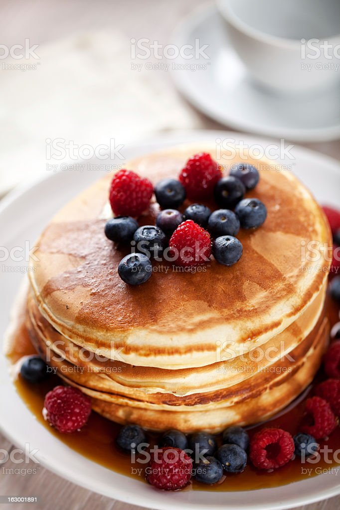Pancakes with berries and maple syrup royalty-free stock photo