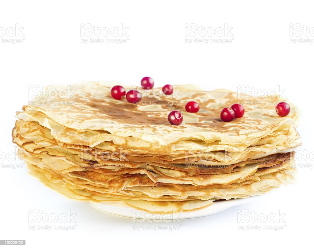 Pancakes with berries on a white plate royalty-free stock photo