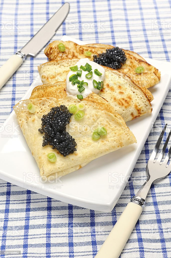Pancakes with black caviar royalty-free stock photo